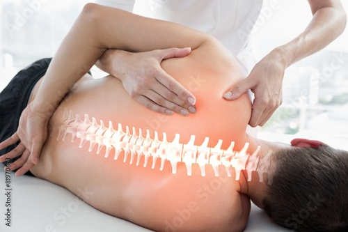 Leinwandbild Motiv Highlighted bones of man at physiotherapy