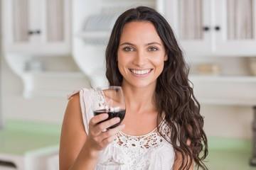 Pretty brunette having a glass of wine