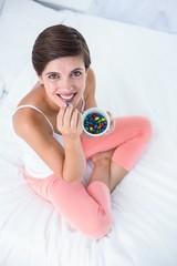 Beautiful woman eating sweet