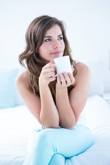 Thoughtful woman drinking a cup of coffee