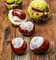 chestnuts on an old table - autumnal still life