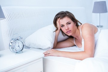 Beautiful woman in bed looking at camera