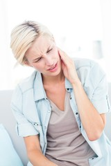 Blonde woman having toothache