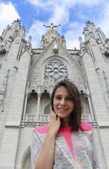 Girl on the background of statue of Christ. Tibidabo, Barcelona