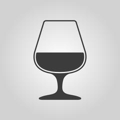 The glass with brandy icon. Brandy symbol. Flat