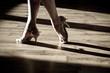 Leinwandbild Motiv Female feet on the dance floor