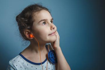a girl of seven European appearance brunette listening to music
