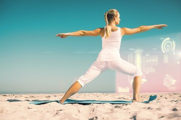 Composite image of calm woman standing in warrior pose on beach