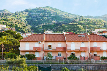 houses in town Gaggi in Sicily on green hills
