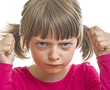 angry little girl on white background