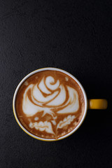Cup of cappuccino on dark background. Top view