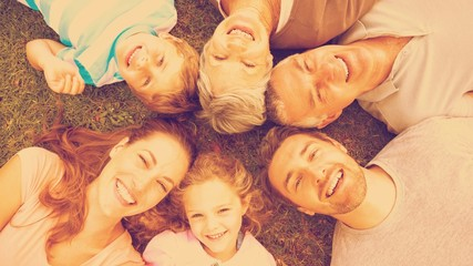 Extended family lying in circle at park