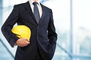 Engineering. Engineer yellow helmet for workers security on the