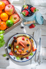 Sweet pancakes with maple syrup and fruits