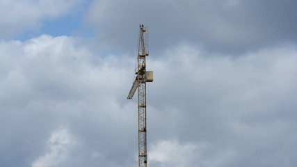 Crane on a background cloudy sky. Time Lapse