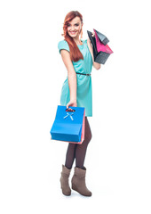 Happy smiling young woman with shopping bags