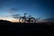 electric bicycle in sunset - 81980239