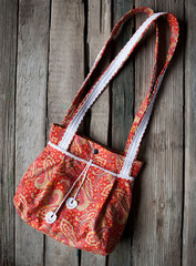 woman fabric bag over rustic wooden background