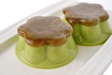 Matcha green tea custard with sweet minced red bean on plate