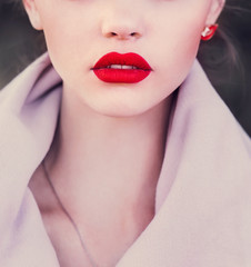Girl with red lips. Photo in violet tones