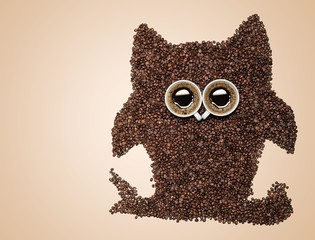 Abstract. Easy way to the nightlife. A funny owl, made of coffee