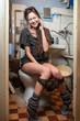 Leinwanddruck Bild - girl talking on the phone in the toilet