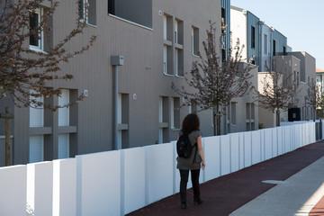 Newly built modern block of flats under blue sky