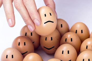 An egg selected among others, feeling sad