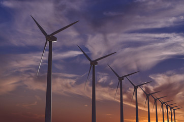 Wind farm at sunset - 3D rendered illustration