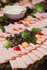 Sliced ham on a holiday buffet