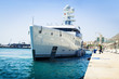 Luxury yacht docking at port. - 81984888