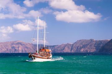 Sailing ship near Santorini coast, Greece