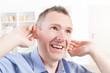 Man wearing deaf aid