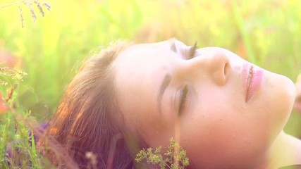Beautiful Girl Lying on the Meadow and Dreaming