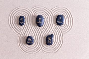 Zen art with stones on golden sand