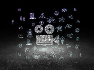 Tourism concept: Camera in grunge dark room