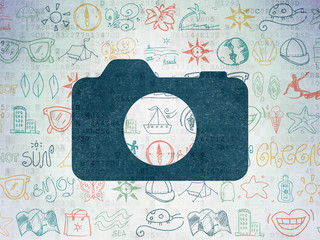 Travel concept: Photo Camera on Digital Paper background