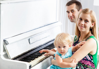 Happy family near the piano
