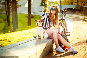 Smiling Hipster Girl with her Dog and Bike