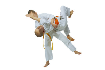 Girl throws the boy through the thigh on the mat