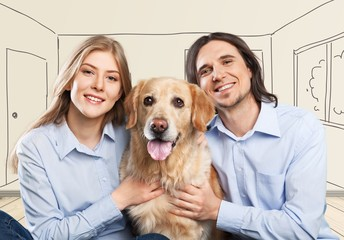 Store. Happy couple taking their beautiful dog to the vet