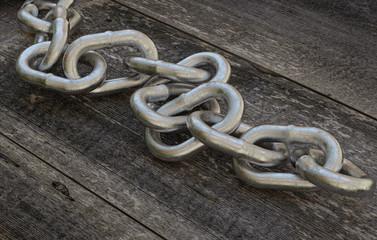 Metallic Chain on wooden Background