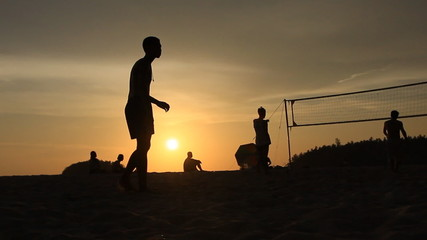 Beach volleyball at sunset time