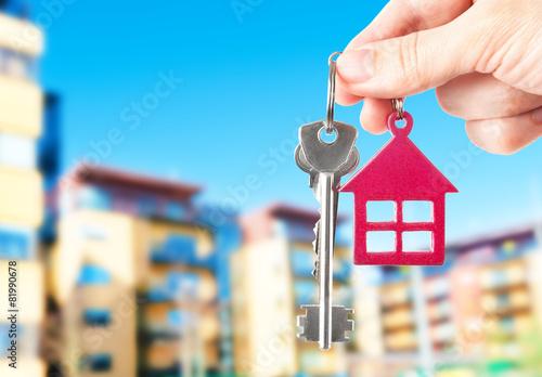 Leinwandbild Motiv Handing keys in the house background