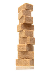 Sugar cubes tower isolated on white background