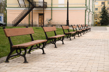Several benches for sitting in a city park