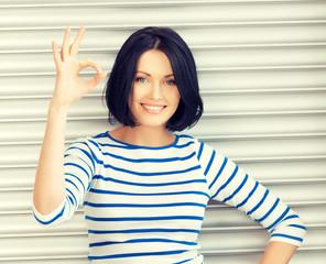 happy teenage girl showing ok sign
