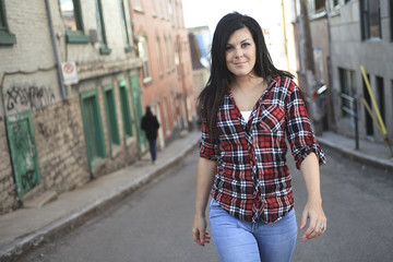 Cheerful woman in the street walking