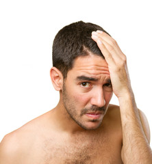 Young man concerned about hair loss