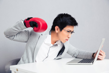 Young businessman in boxing gloves